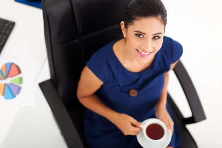 above view of beautiful businesswoman having tea photo