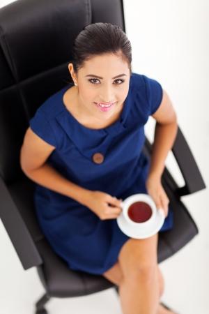 executive chair: portrait of gorgeous businesswoman on tea break