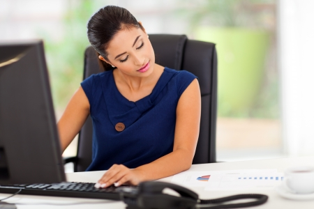 workstations: beautiful young businesswoman working in her modern office
