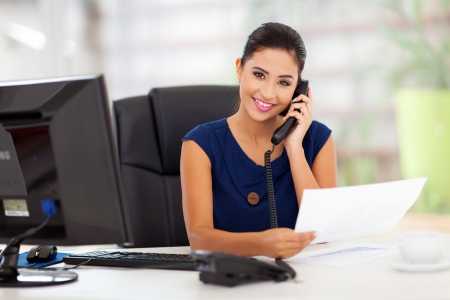 answering: portrait of young secretary answering telephone