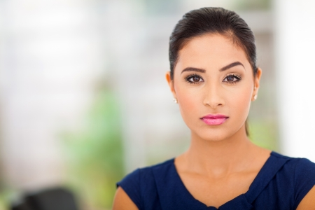 beautiful indian girl face: cool businesswoman in office close up Stock Photo