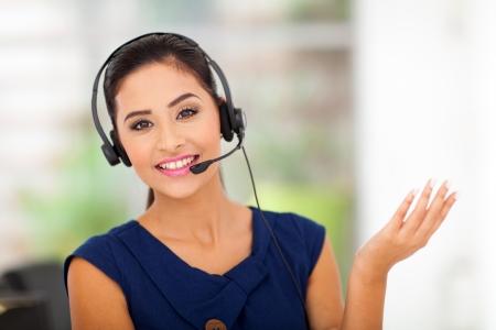 up service: Closeup of a beautiful business customer service woman smiling Stock Photo