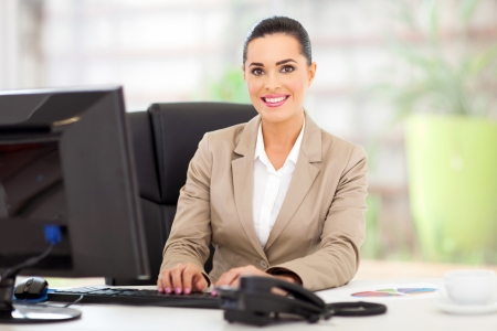 portrait of beautiful young businesswoman in office Stock Photo - 18983541