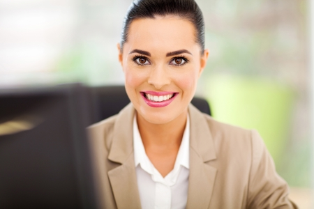 happy businesswoman in office close up Stock Photo - 18983540