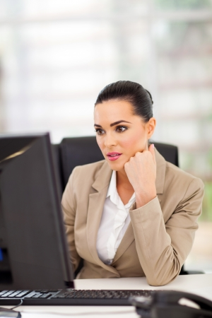 Pretty business woman working at office desk Stock Photo - 18983707