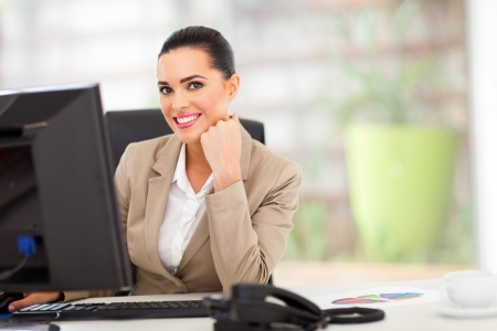 portrait of happy white business woman in office Stock Photo - 18983648