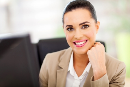 Portrait of pretty young business woman smiling Stock Photo - 18983599