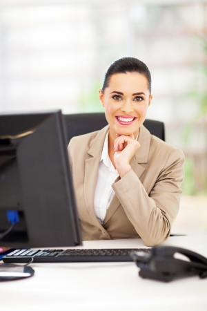 happy career woman in office smiling Stock Photo - 18983640
