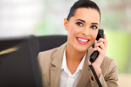 pretty switchboard operator answering telephone Stock Photo - 18983604