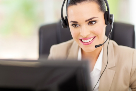 pretty female support center operator with headset photo