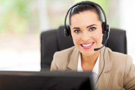 Portrait of friendly call center consultant with headphones photo