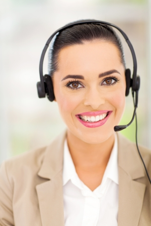 beautiful female customer support operator with headset smiling Stock Photo - 18983564