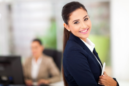 well dressed girl: business woman with tablet computer in the business centre