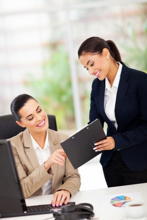 cheerful business women working in office photo