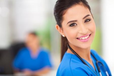 closeup portrait of young female medical worker in office Stock fotó