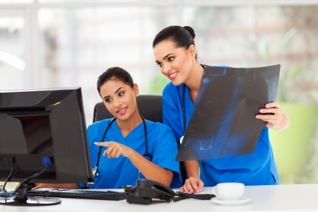 two beautiful female healthcare workers working in office photo