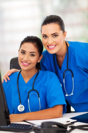 two attractive modern female healthcare workers in office photo