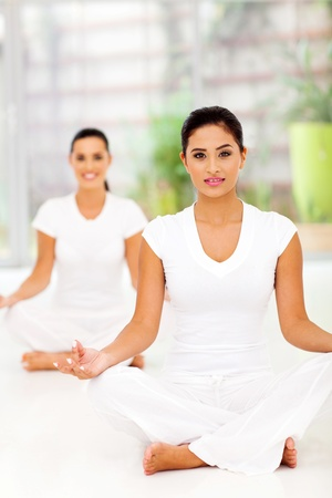 attractive young healthy women meditating photo