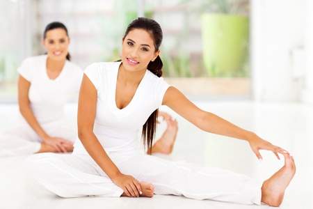 meditating woman: Beautiful young women doing stretching exercise
