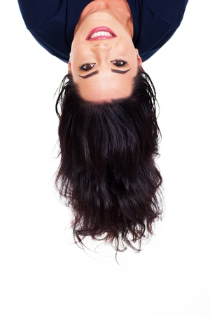 head down: young woman head upside down