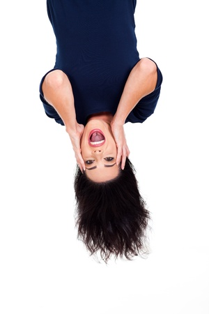 upside down: upside down photo of beautiful young woman looking surprised