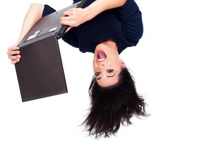 gravedad: boca abajo foto de la muchacha que usa el ordenador portátil Foto de archivo