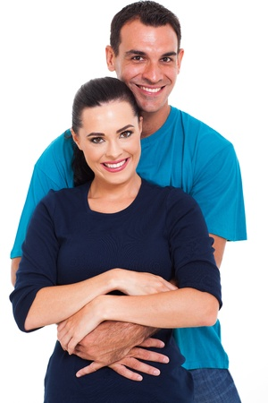 arms around: portrait of a handsome man arms around his beautiful wife over white background