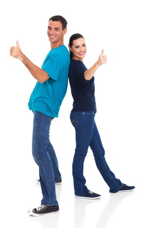 man thumbs up: cute loving couple giving thumbs up, leaning on each other on white background