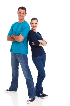 portrait of cheerful young couple leaning on each other over white background photo