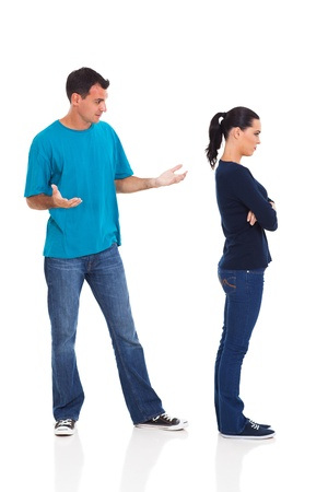 people arguing: unhappy couple having argument isolated on white background Stock Photo
