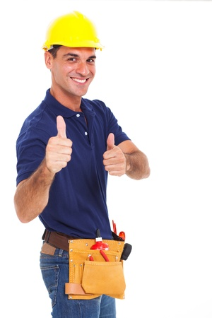 portrait of young constructor giving thumbs up over white background Stock Photo - 18992069