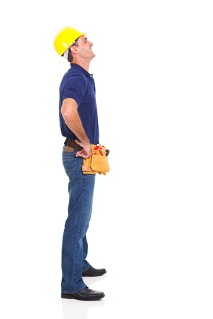 blue collar: full length of happy repairman looking up isolated on white background Stock Photo