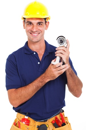 portrait of happy male cctv installer holding a camera over white background photo