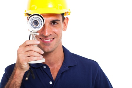 fun cctv installer looking through cctv camera over white background photo