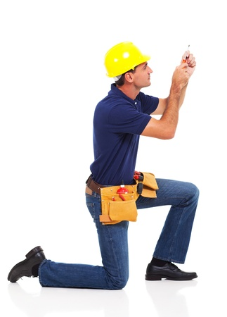 blue collar: handyman working using screwdriver over white background
