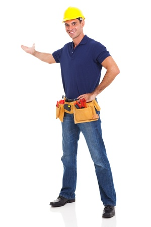 portrait of cheerful handyman presenting over white background photo