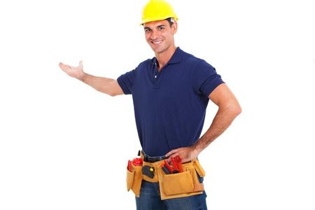 portrait of smiling handyman presenting on white background Stock Photo - 18992105