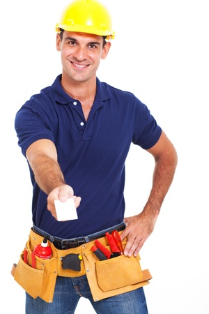 handsome handyman handing over his business card over white background photo