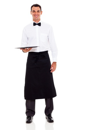 uniform attire: handsome young waiter with empty tray isolated on white