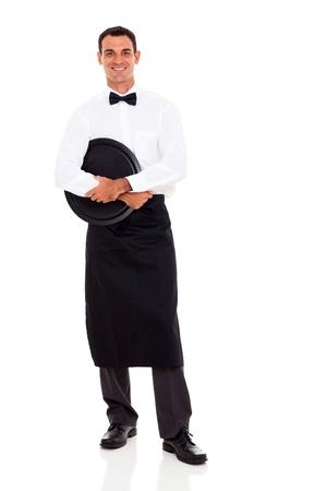 delantal: camarero joven retrato de cuerpo entero en blanco Foto de archivo