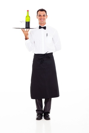 uniform attire: handsome wine steward with tray of wine and glass Stock Photo