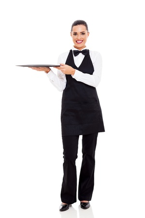 full uniform: cute young waitress holding an empty tray