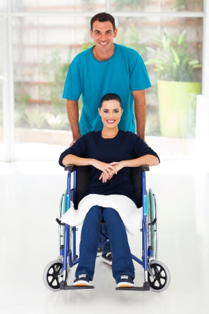 recovering: happy disabled woman and her caring husband at home