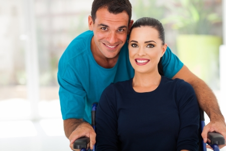 loving husband and disabled wife closeup portrait photo
