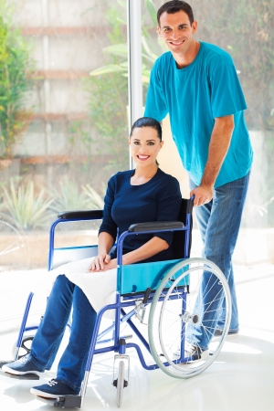 caring husband and handicapped wife at home photo