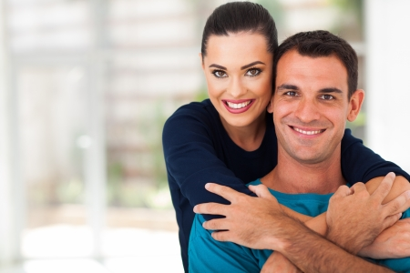 young lovers: romantic young couple hugging together Stock Photo
