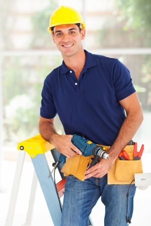 installer: happy cctv system installer with tools Stock Photo