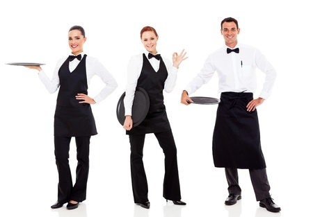 uniform attire: group of friendly restaurant staff isolated on white Stock Photo