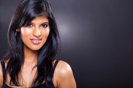 indian girl: portrait of beautiful female indian model close up isolated on black background