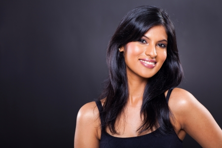 american sexy girl: portrait of happy young woman isolated on black background
